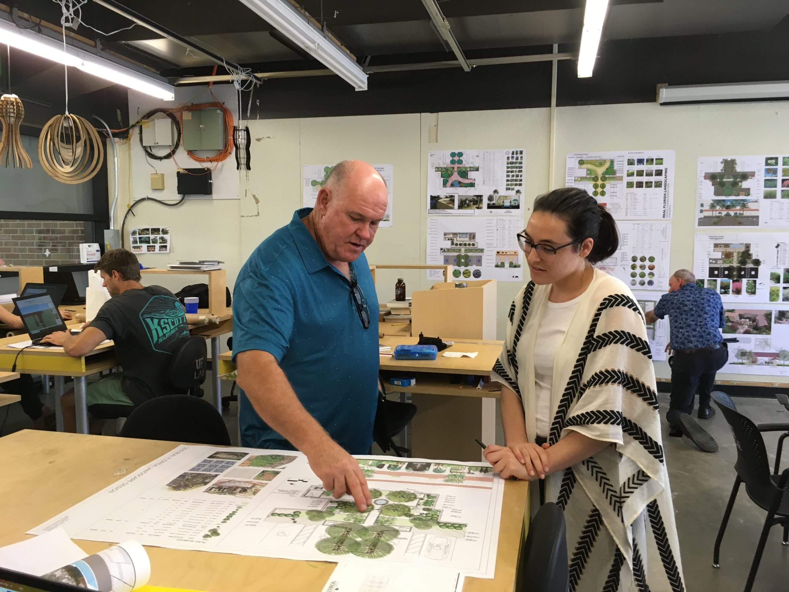 Foundation President Bruce Turley discusses plan with student